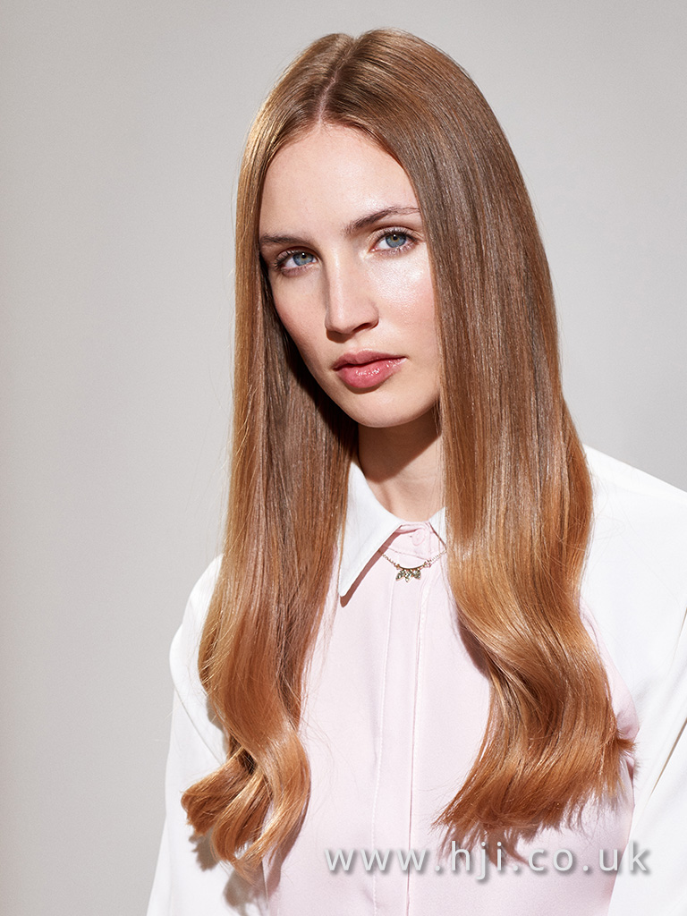 2016 light brunette straight hairstyle with slight curl at bottom