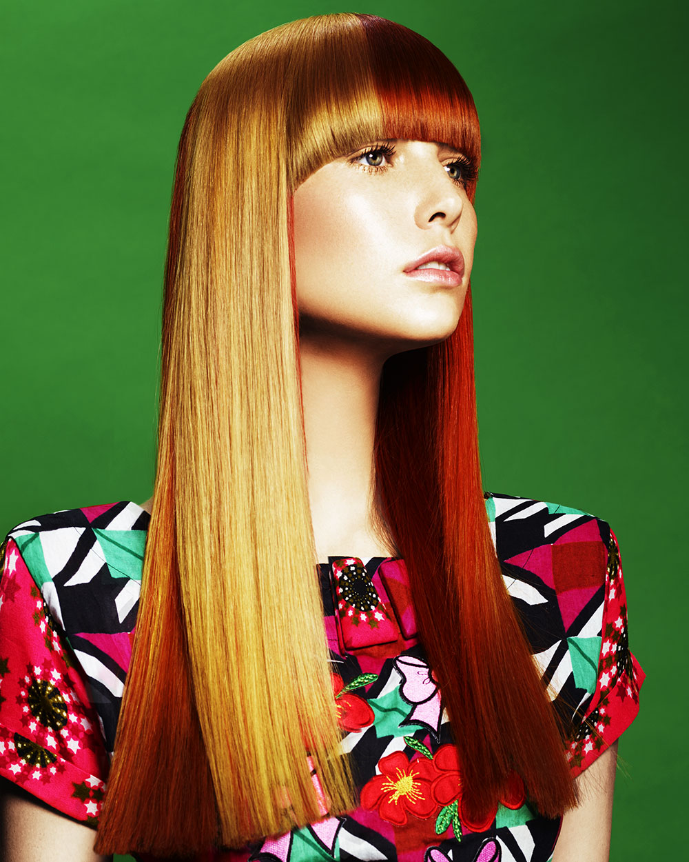 Two-tone long straight hairstyle with full fringe.