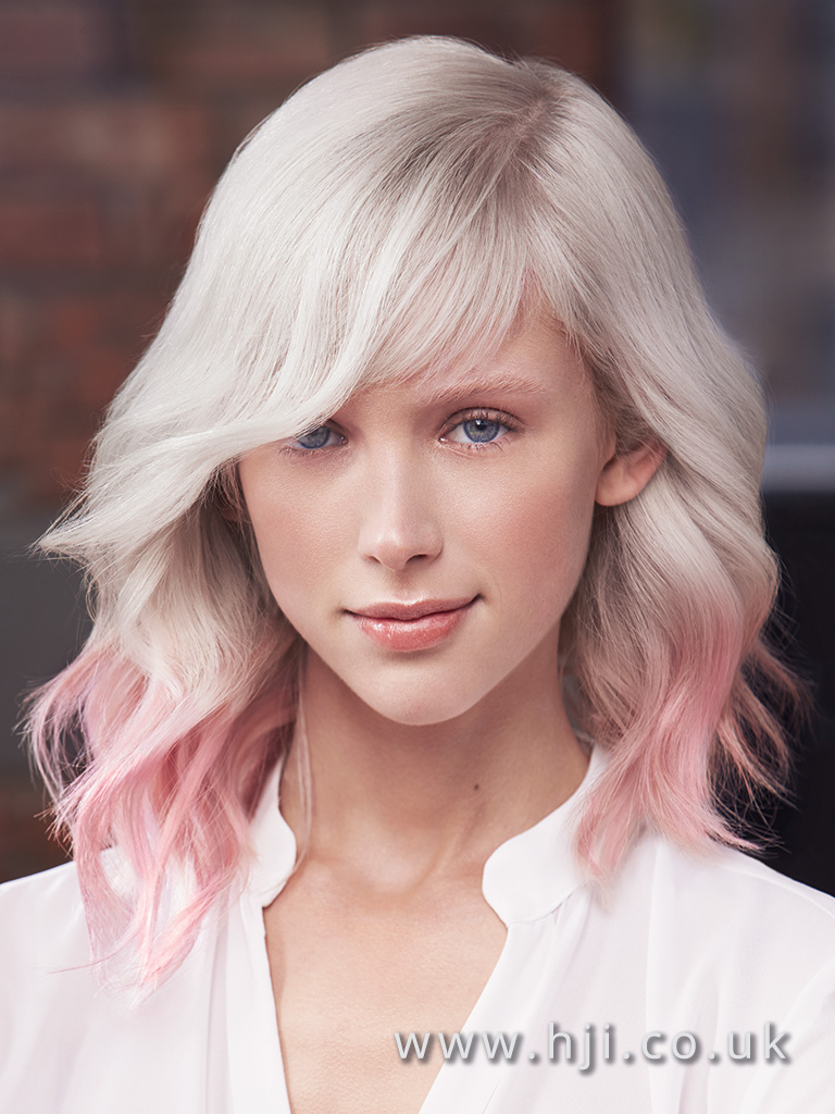 2017 Matrix Platinum Blonde Mid Length style with beachy waves side swept fringe and pastel pink ombre
