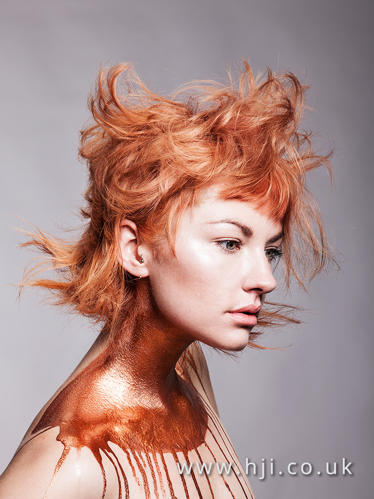 Messy textured copper coloured hairstyle