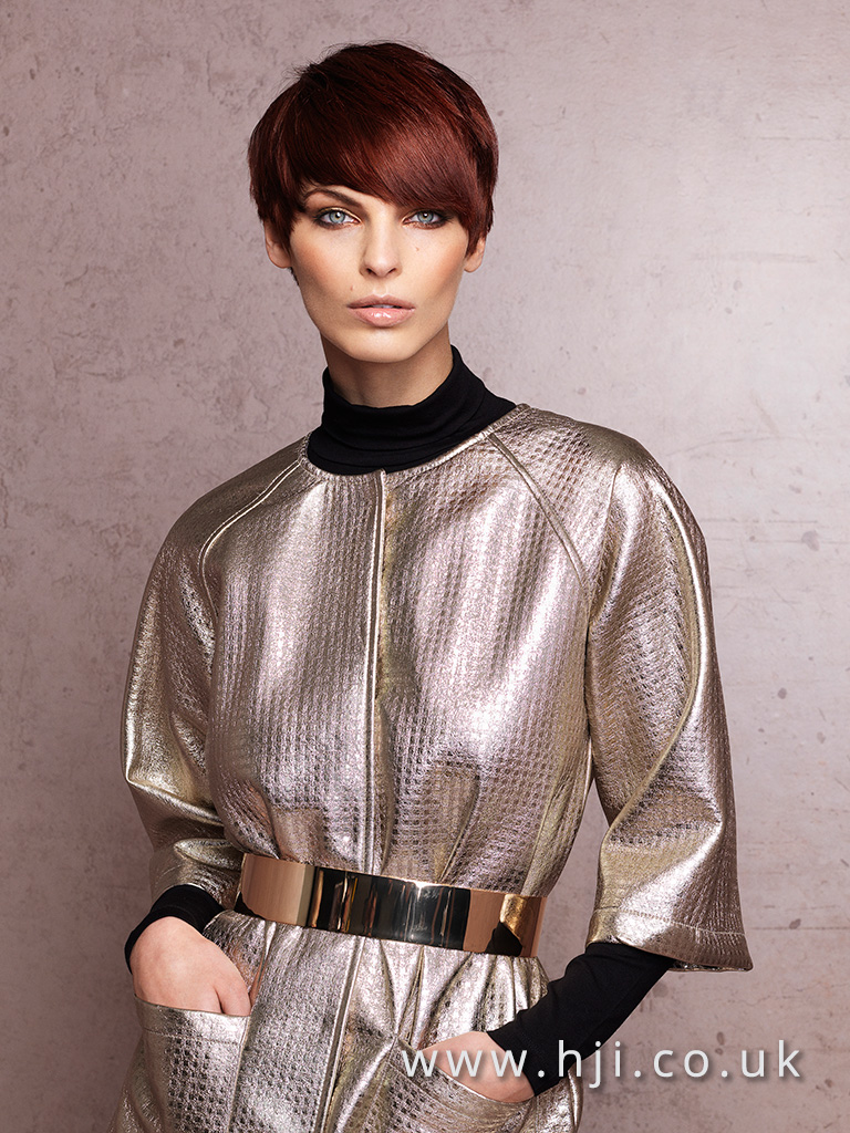 Short redhead cut with side sweeping fringe