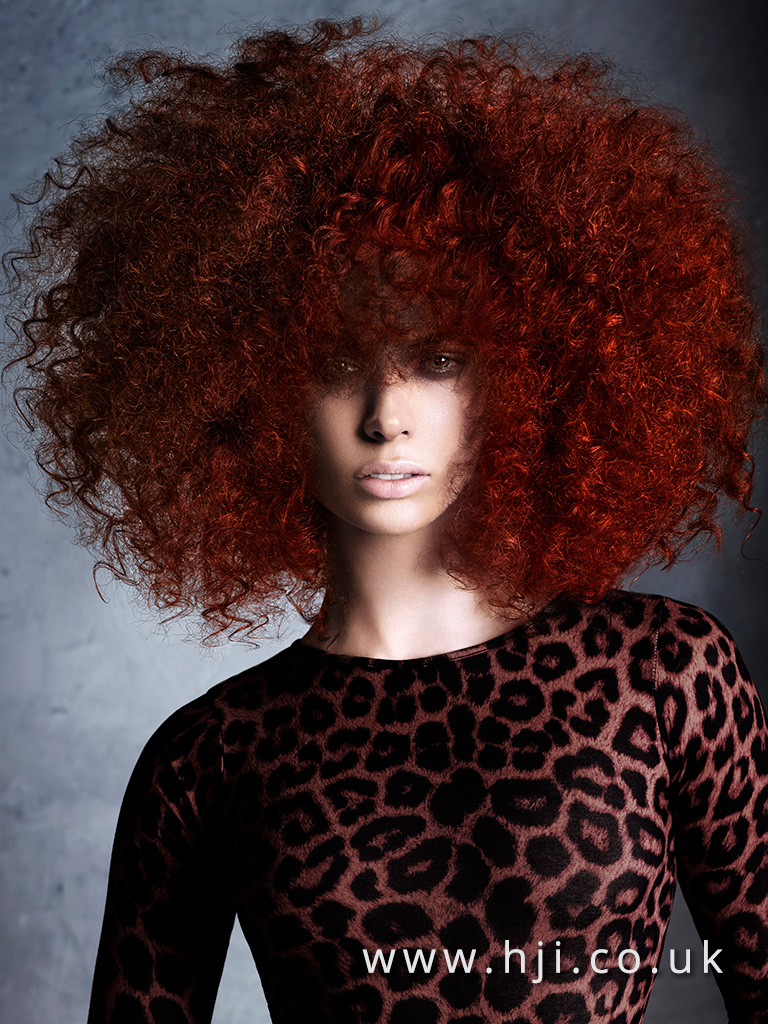 Big redhead hairstyle with fringe by Alan Keville