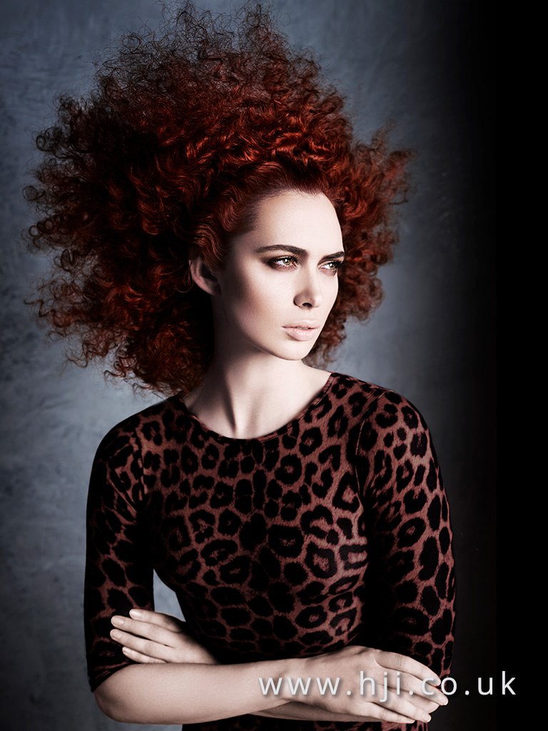 Voluminous red curly hairstyle by Alan Keville