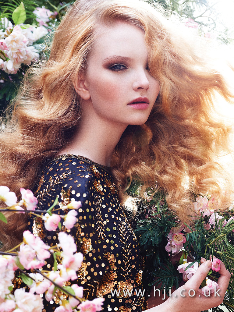 Long flowing curly redhead hairstyle