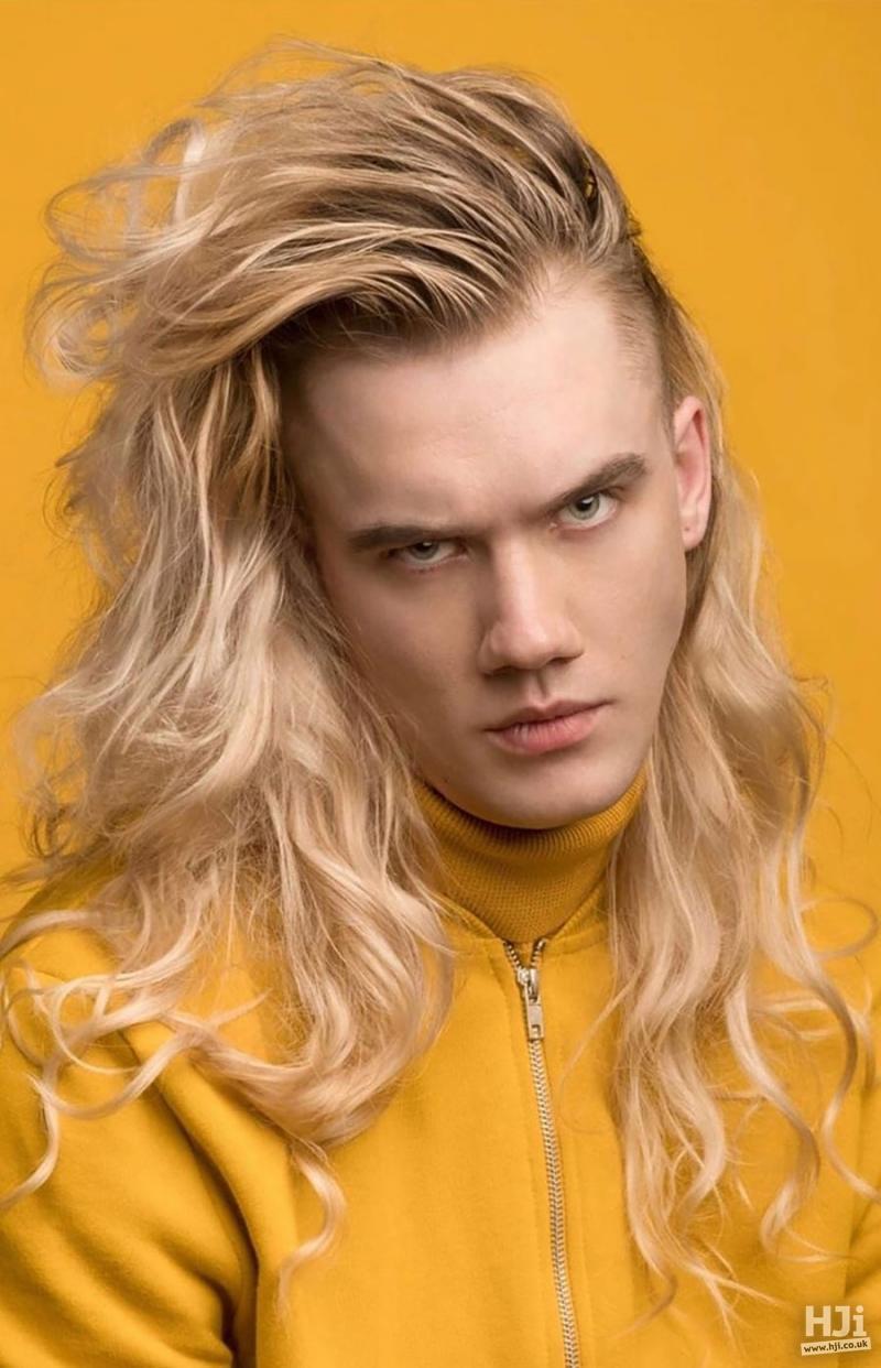 Very long, blonde, quiff, waves
