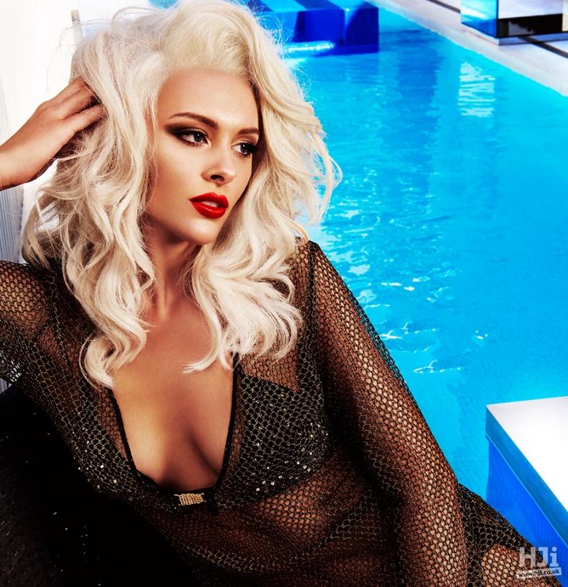 Mid-length, platinum blonde, waves
