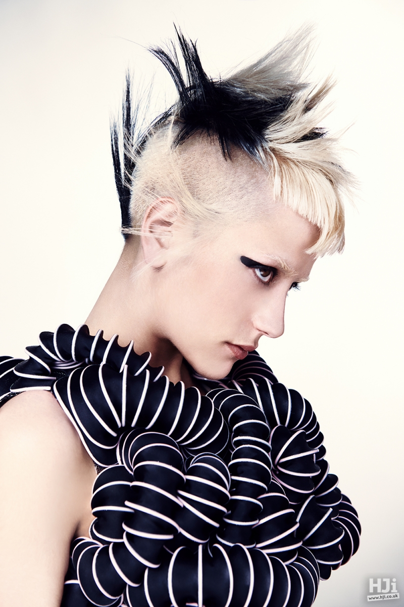 Creative black and blonde colouring on asymmetric short cut
