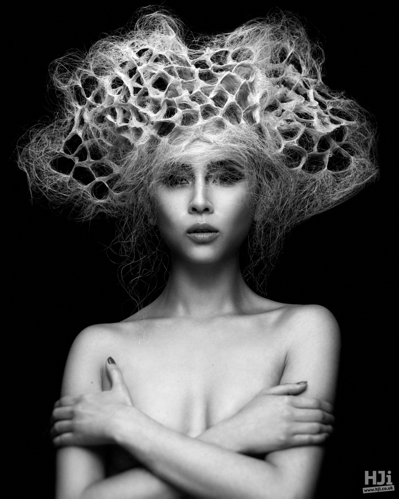 Geometric circular patterning in curly blonde updo