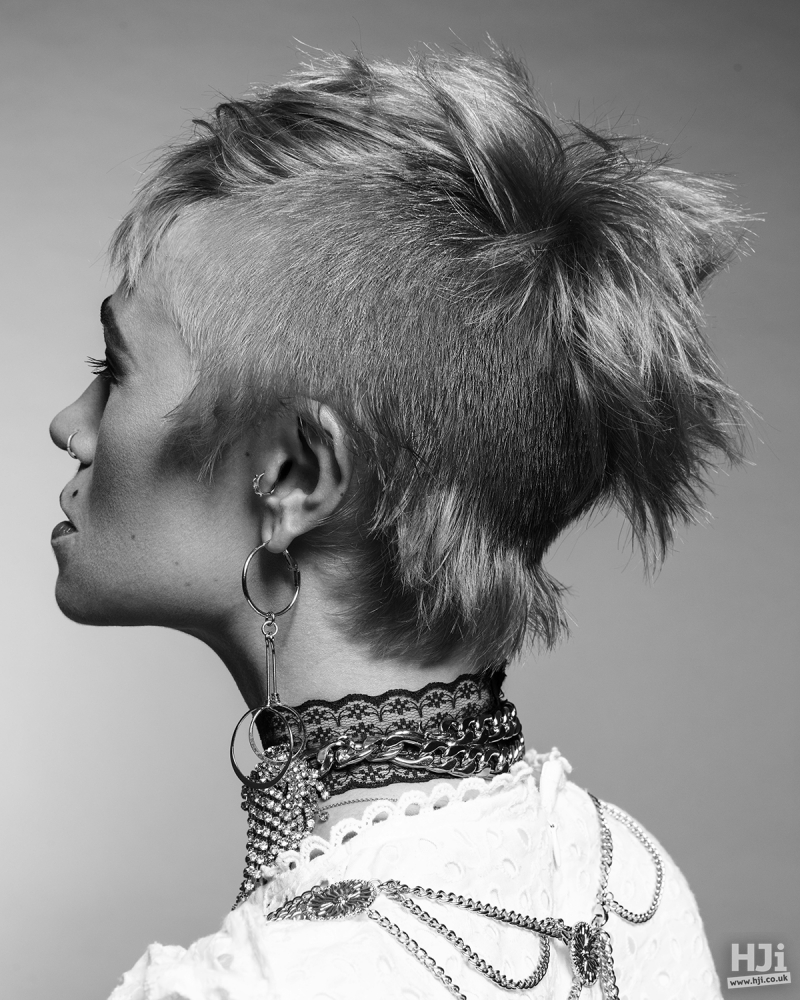 Asymmetric blonde cut with alternating textures