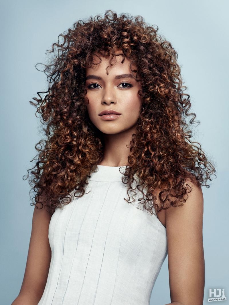 Long brown glossy curls