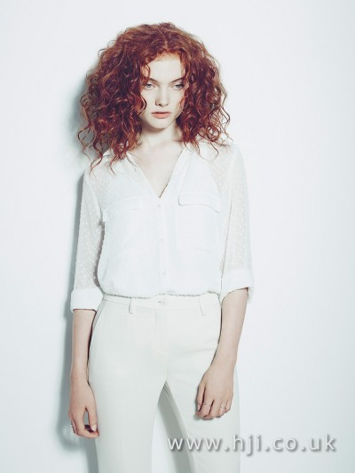 Redhead curls and centre parting hairstyle