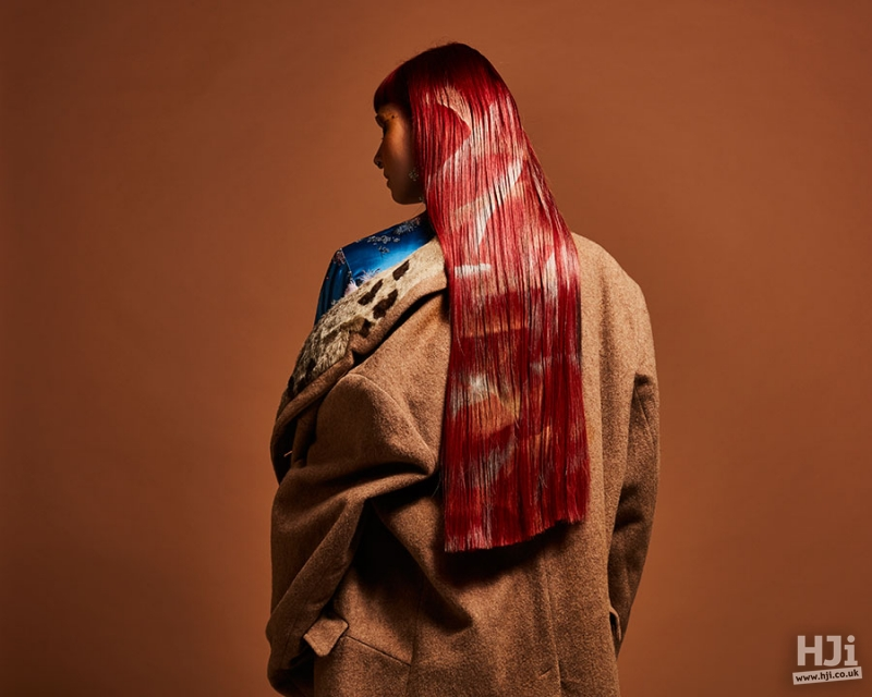 Sleek long bright red hairstyle with withe designs