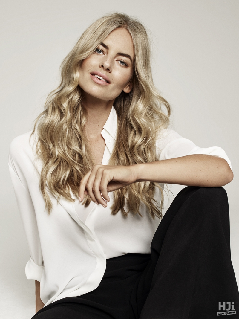 Centre-parted mid-length blonde waves