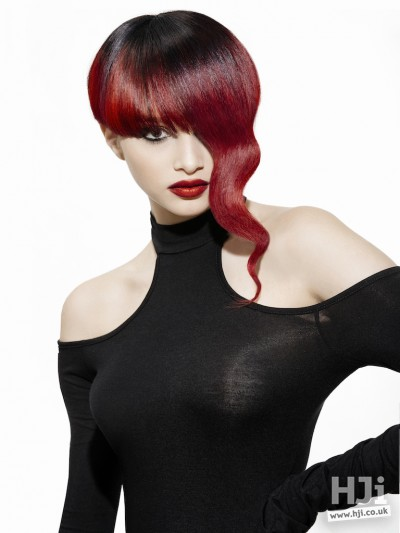 Deep red with black roots, long curl and thick fringe