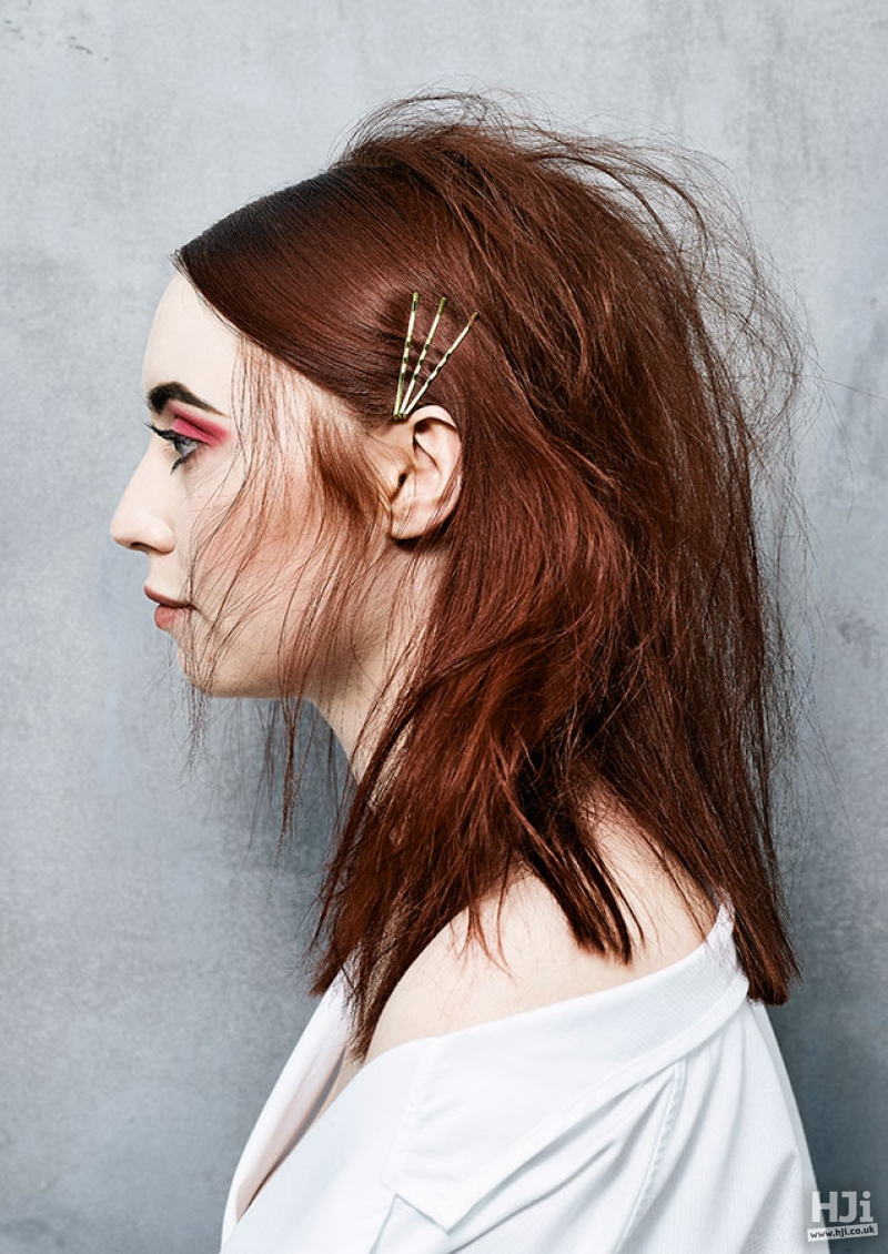 Mid length messy redhead with hair accessories