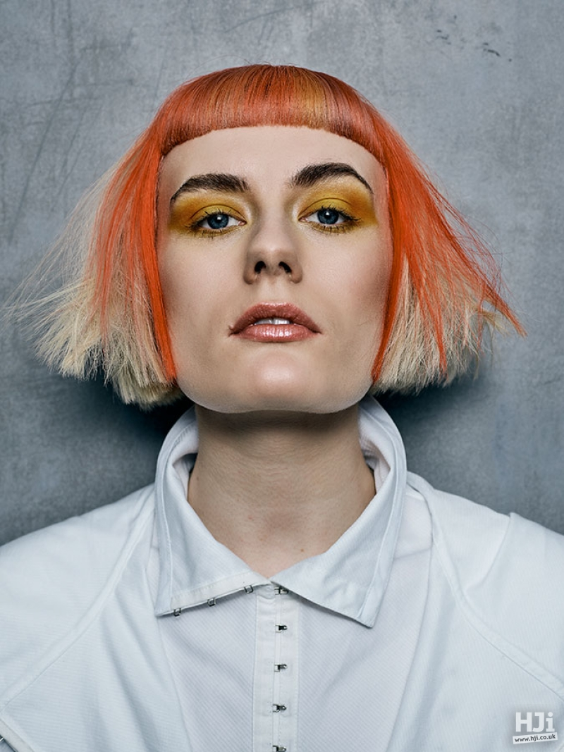 Avant Garde bob with short fringe and peekaboo panels in creative colours
