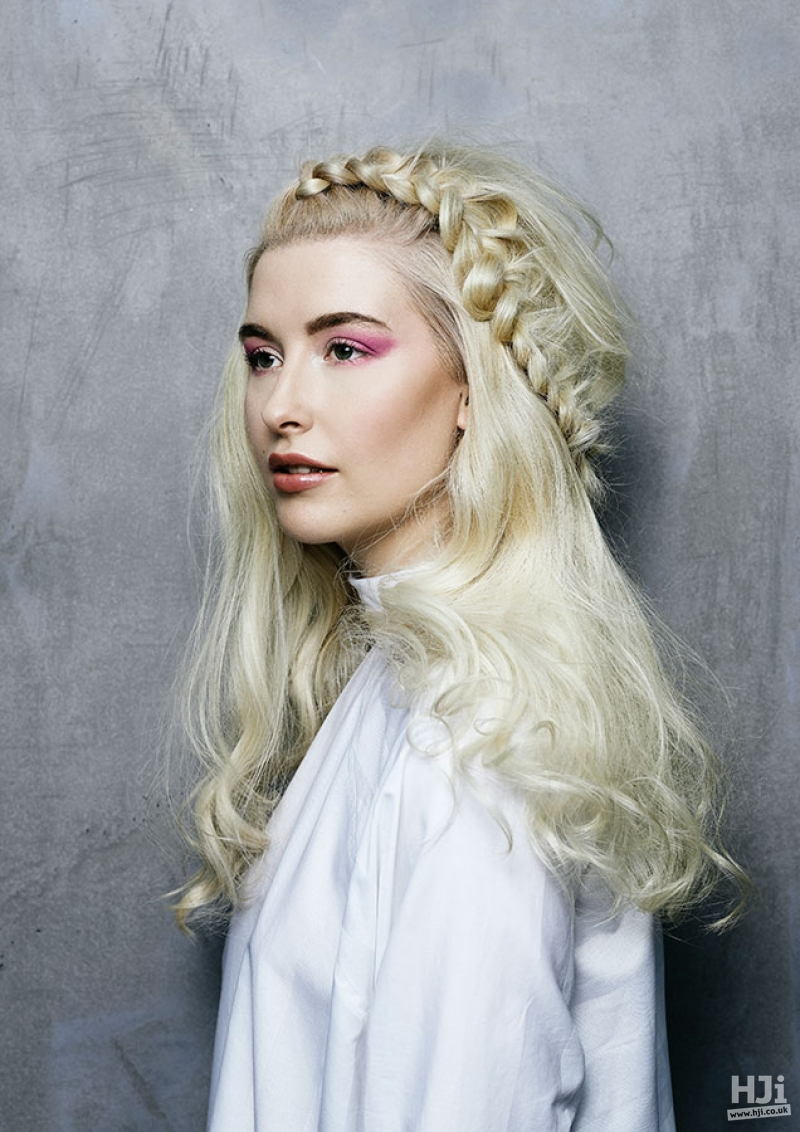 Long wavy blonde haircut styled with a halo braid