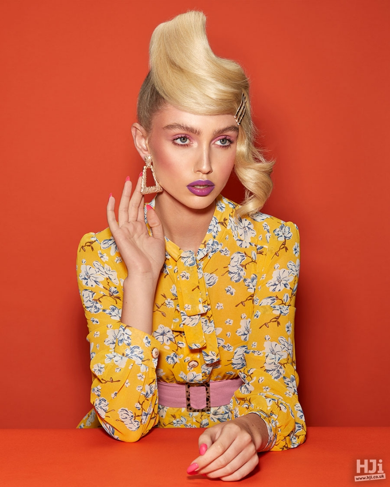Mid-length blonde hair styled in a sleek updo with three clippers