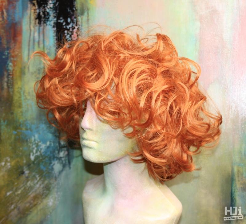 Creative curly bright orange bob