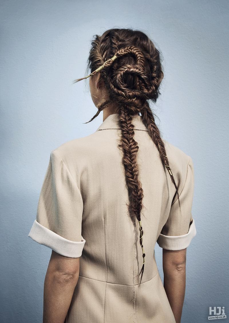 Plaiting in long brunette hair