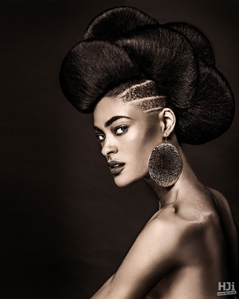 A dramatic and creative hair style with a shaved side
