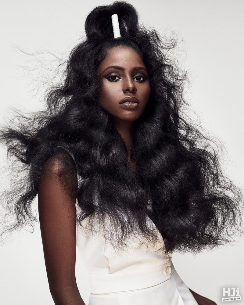 Long brushed curls with hair accessory