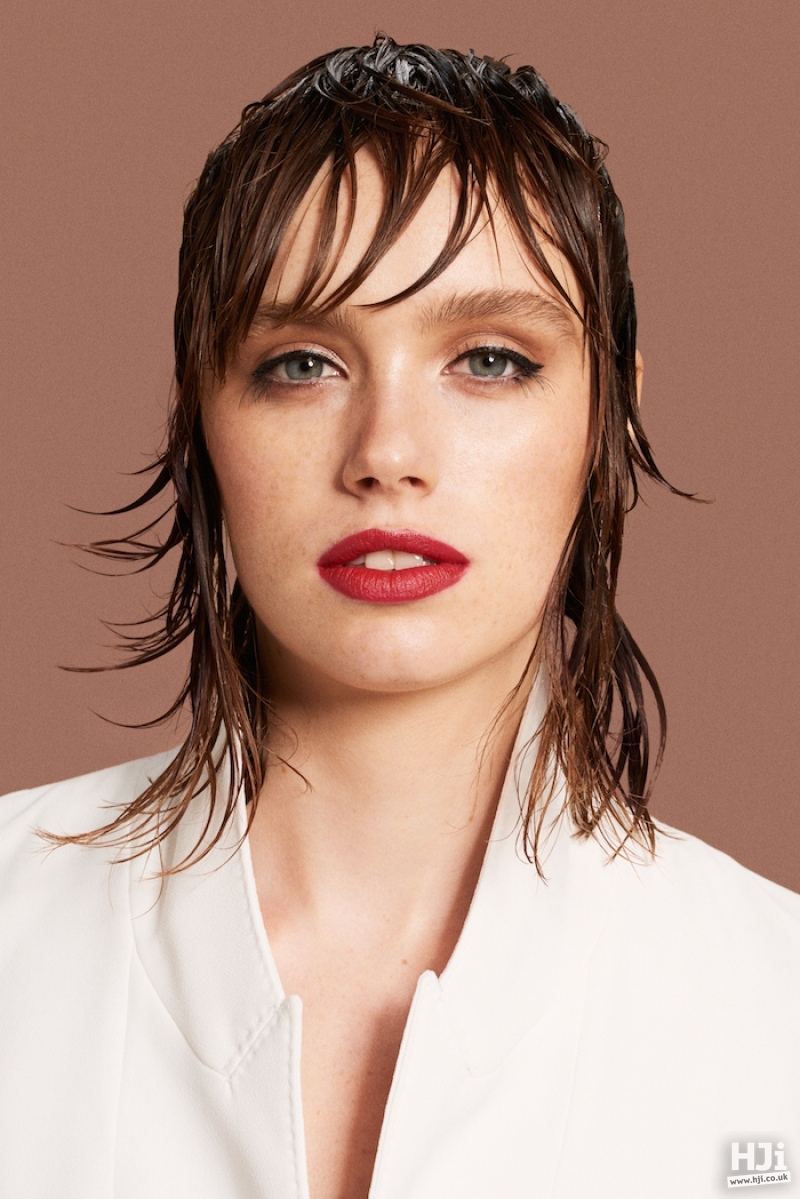 Wet look brunette mid length style with fringe