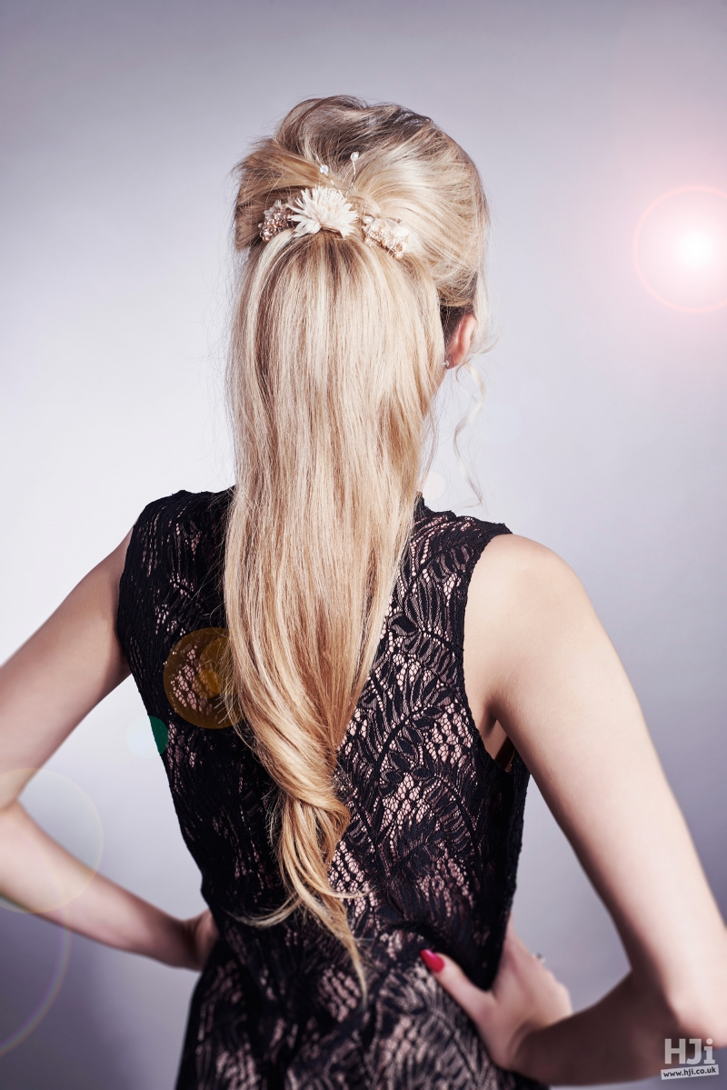 Sleek low ponytail with hair accessory