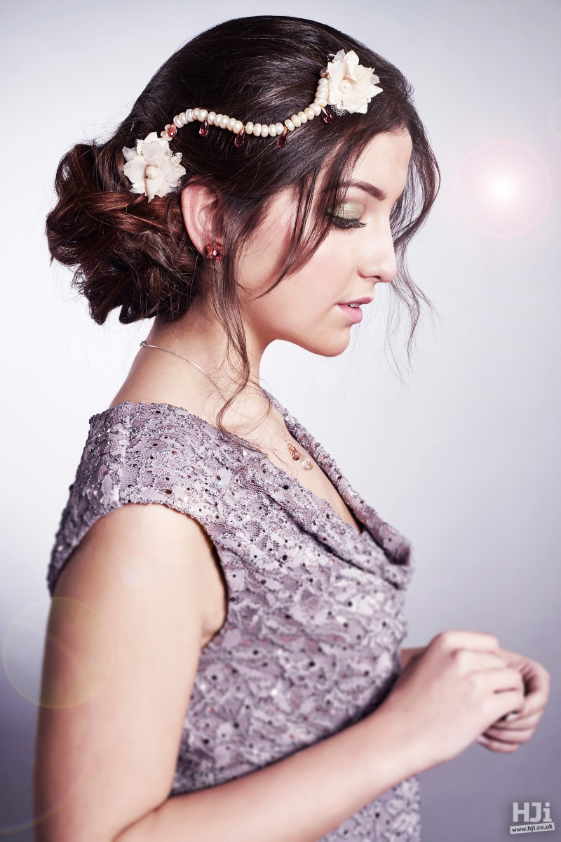 Brunette bridal updo with floral accessory