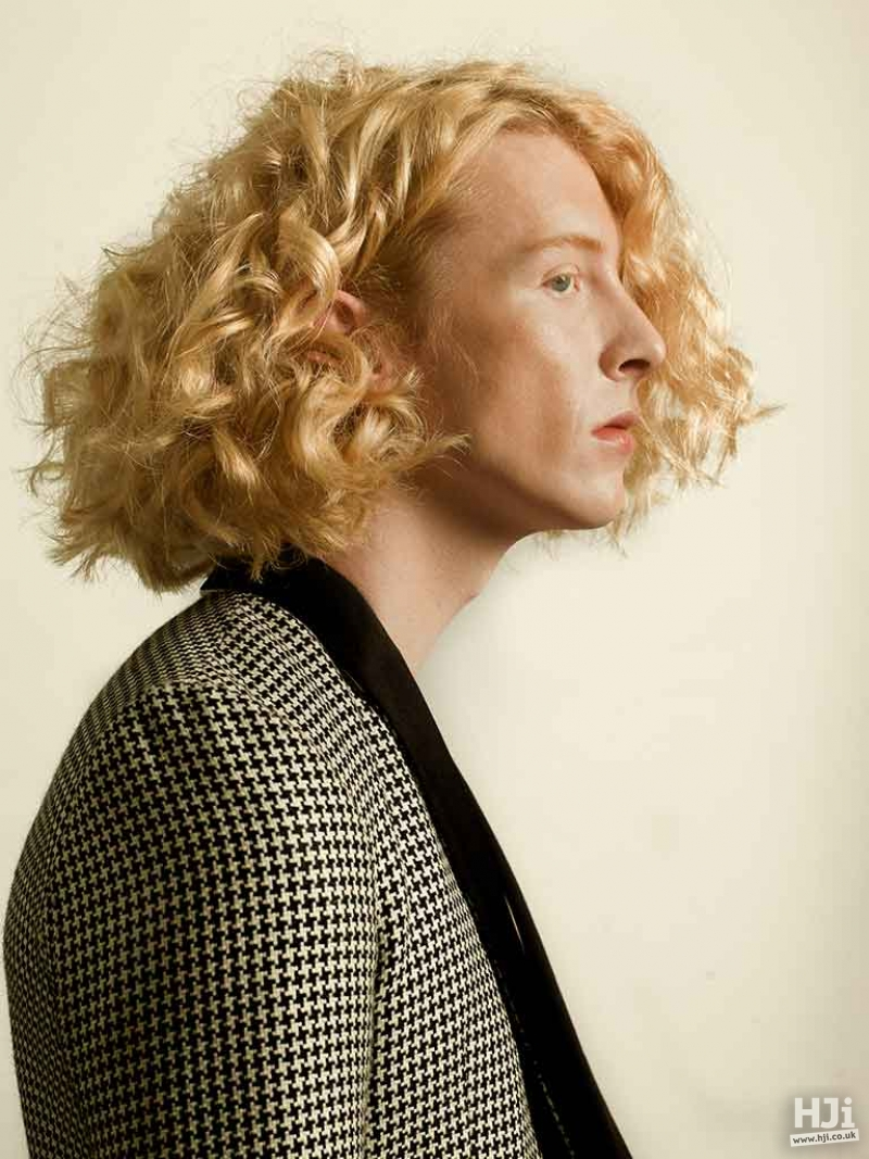 Blonde curly mens hairstyle with centre parting