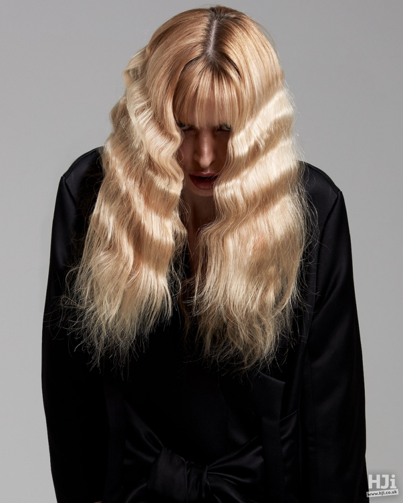 Contrasting textures on long blonde hair.