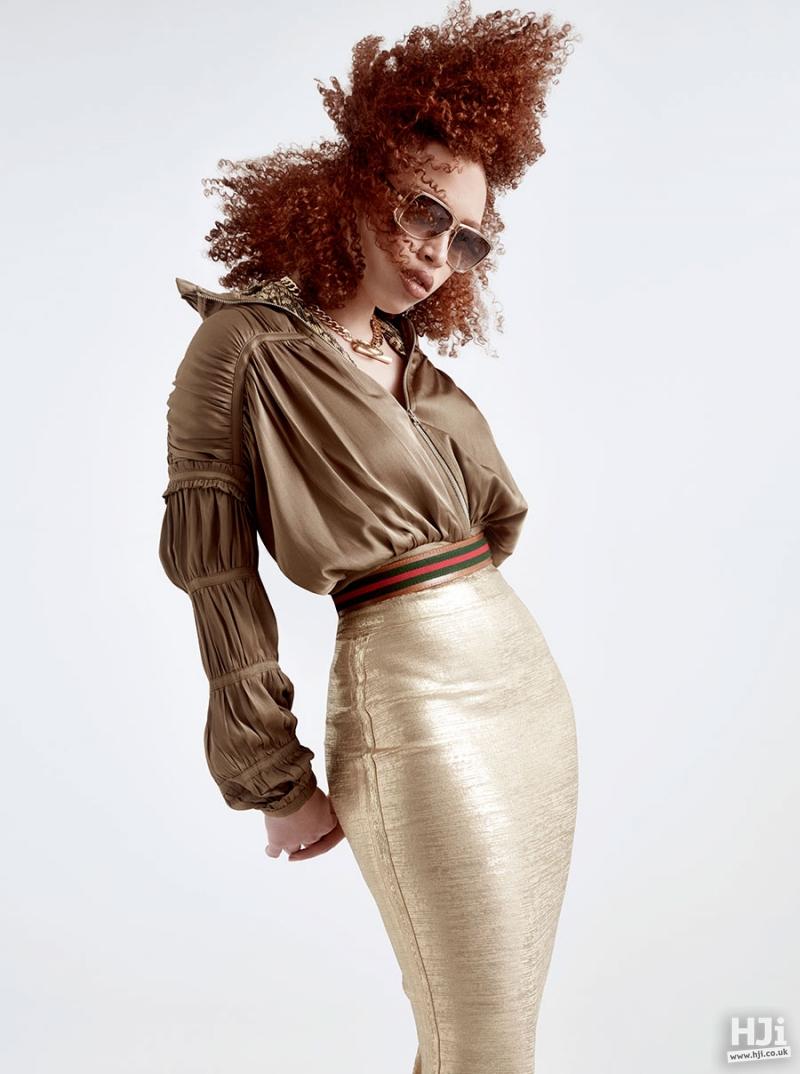 Curly asymmetric redhead hairstyle