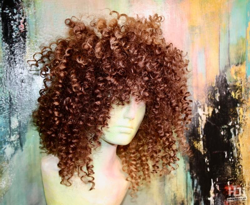 Frizzy light brunette curls