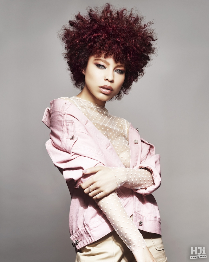 Deep red block colour with short Afro and fringe
