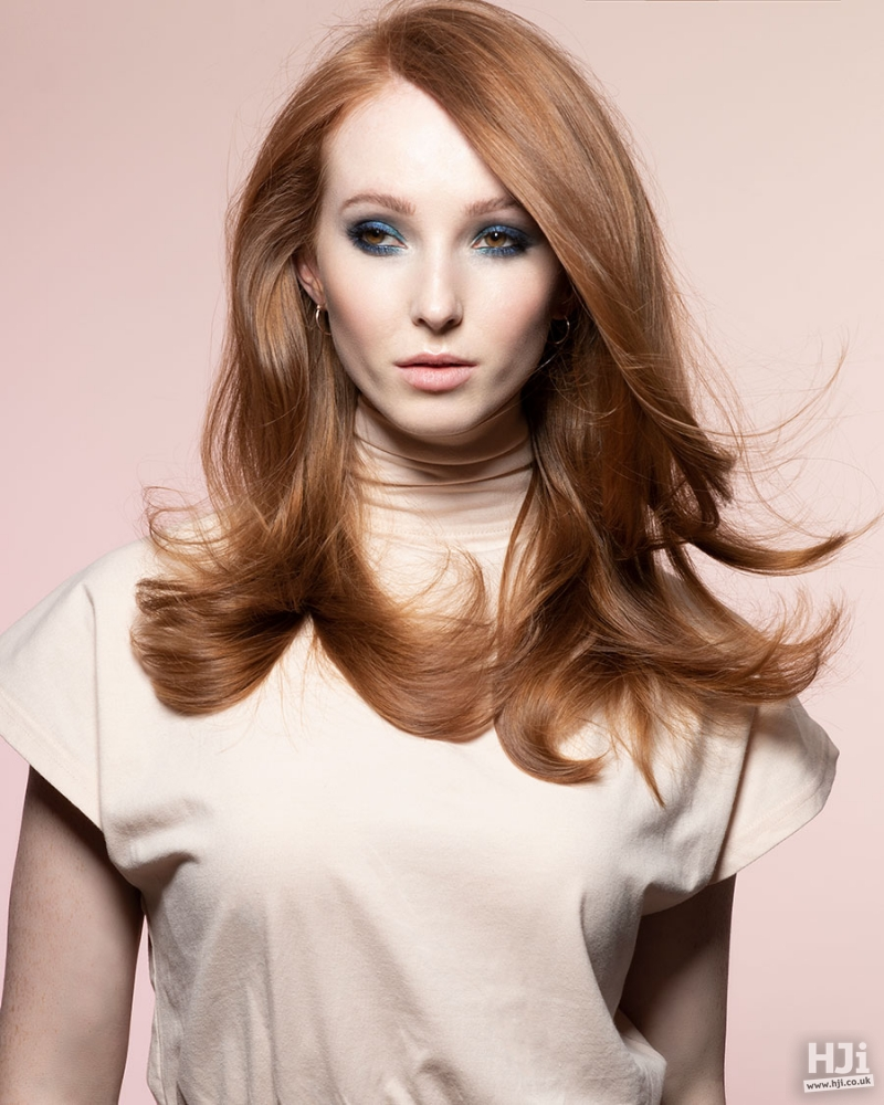 Classic, bouncy blow-dry redhead hairstyle