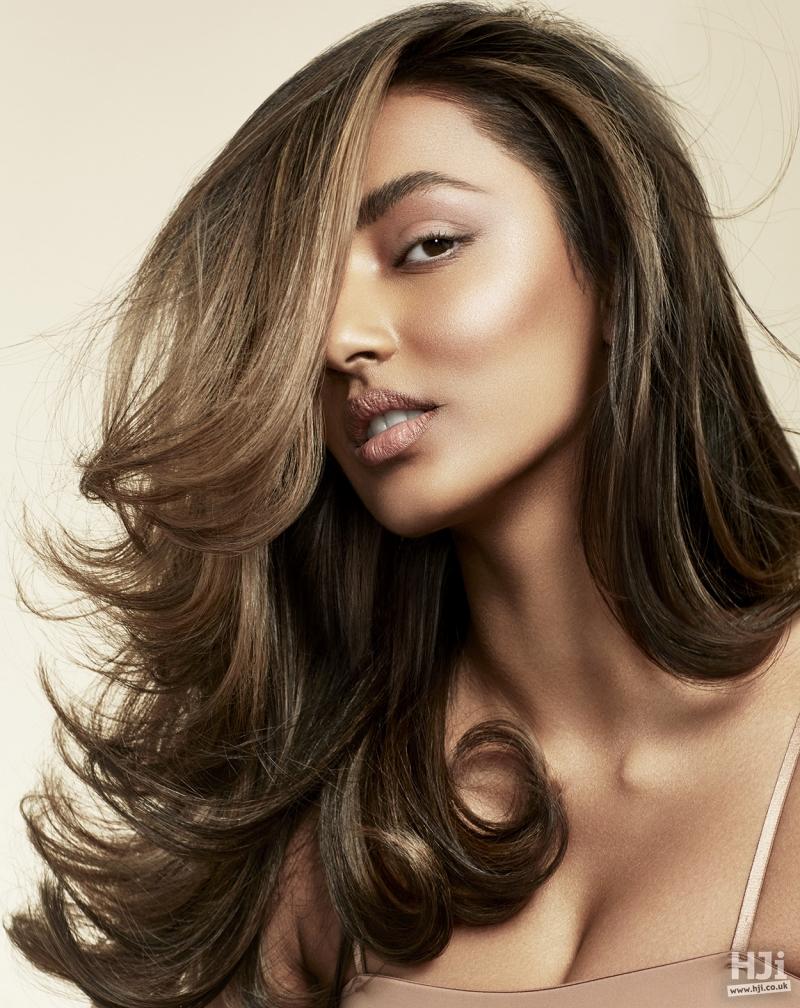 Wavy brunette with sweeping fringe