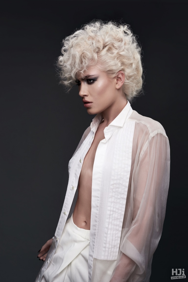 Platinum blonde curled short style with curled fringe