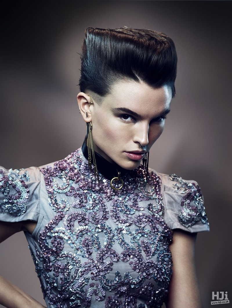 Sleek flat top with cropped sides.