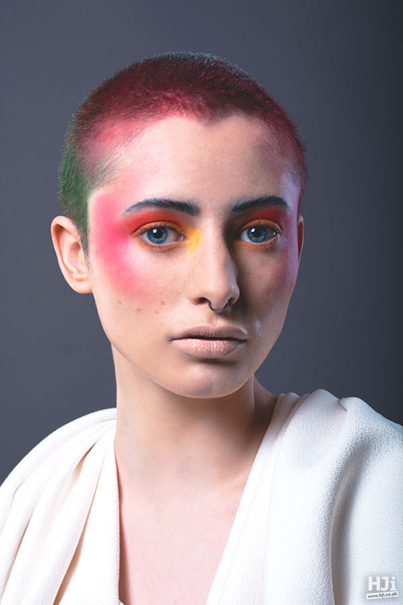 Cropped hairstyle with splashes of bright red and green