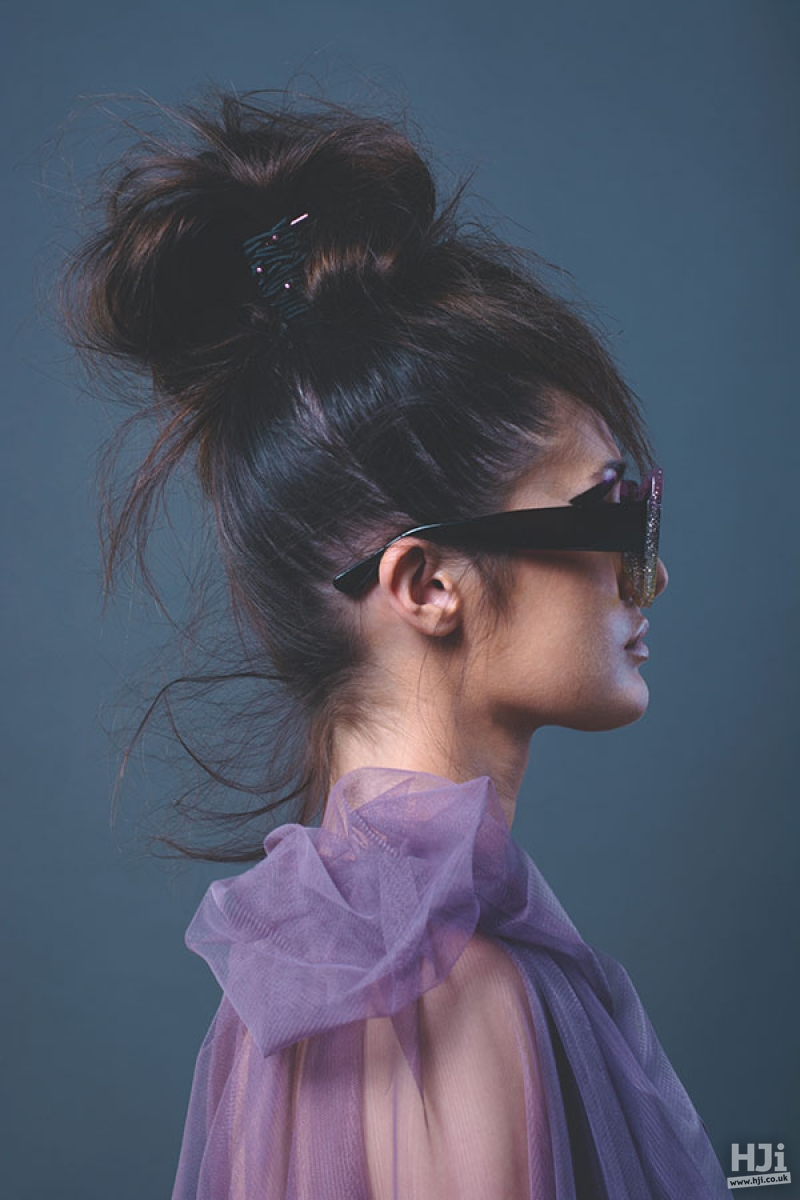 Natural texture brunette with top knots and highlights