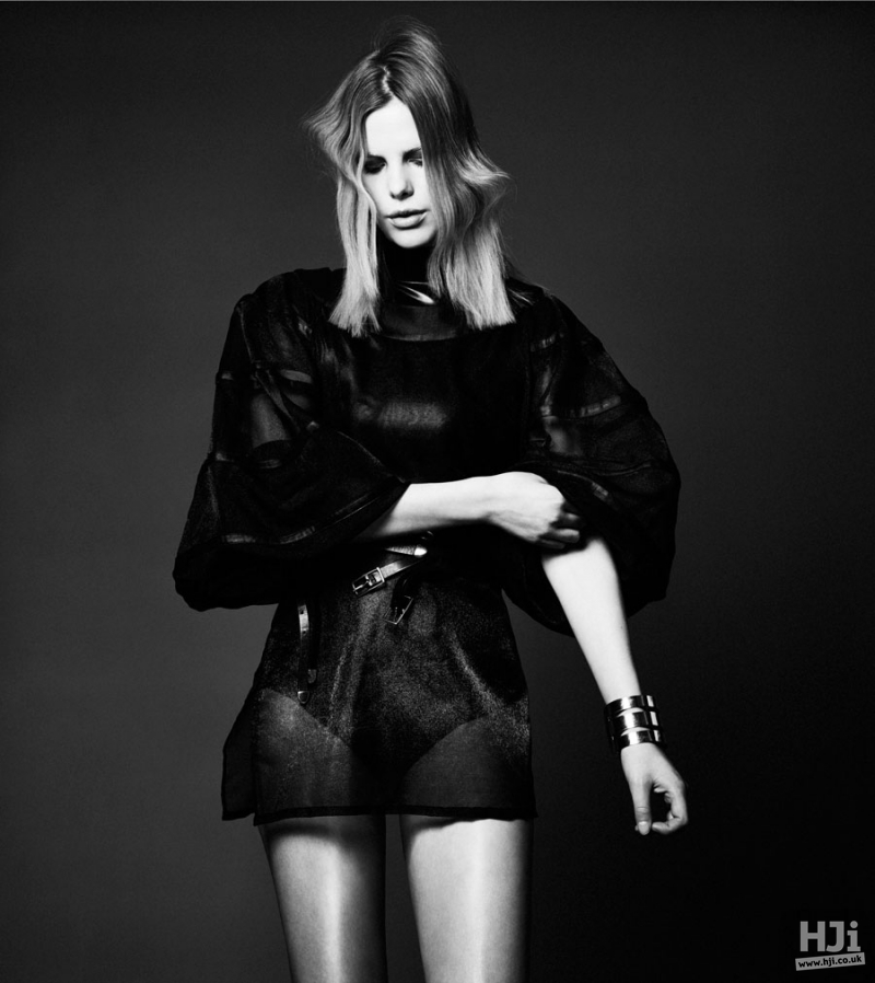 Layered mid length hairstyle in a black and white photoshoot