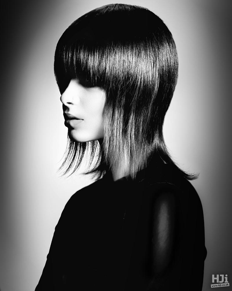 Sleek mid-length brunette with long fringe