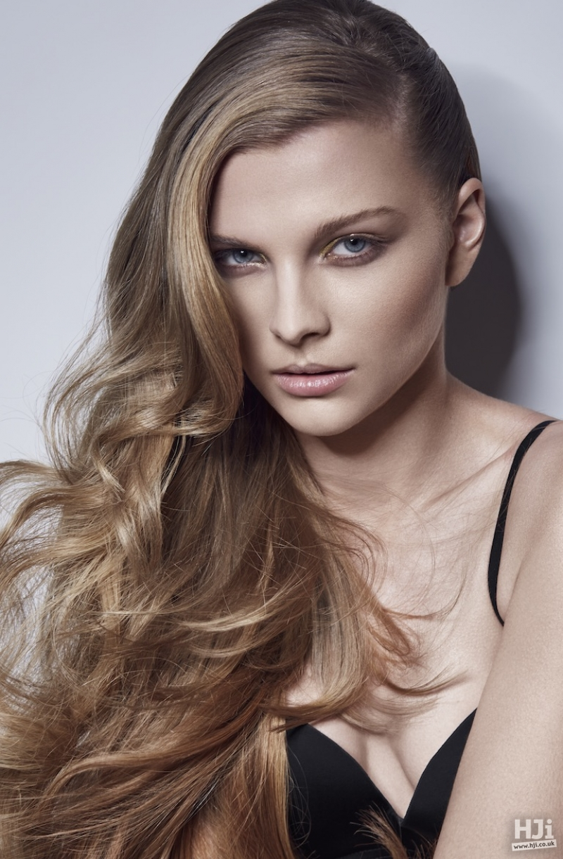 Long sleek style with side-parting and waves
