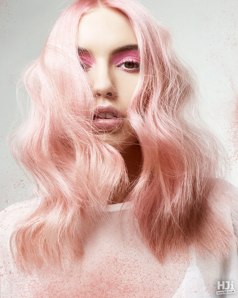 Wavy light pink mid length hairstyle