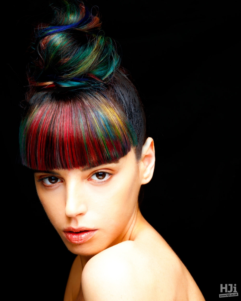 Coloured highlights into high top knot.