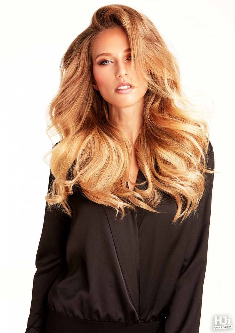 Side part with tousled curls and lots of volume