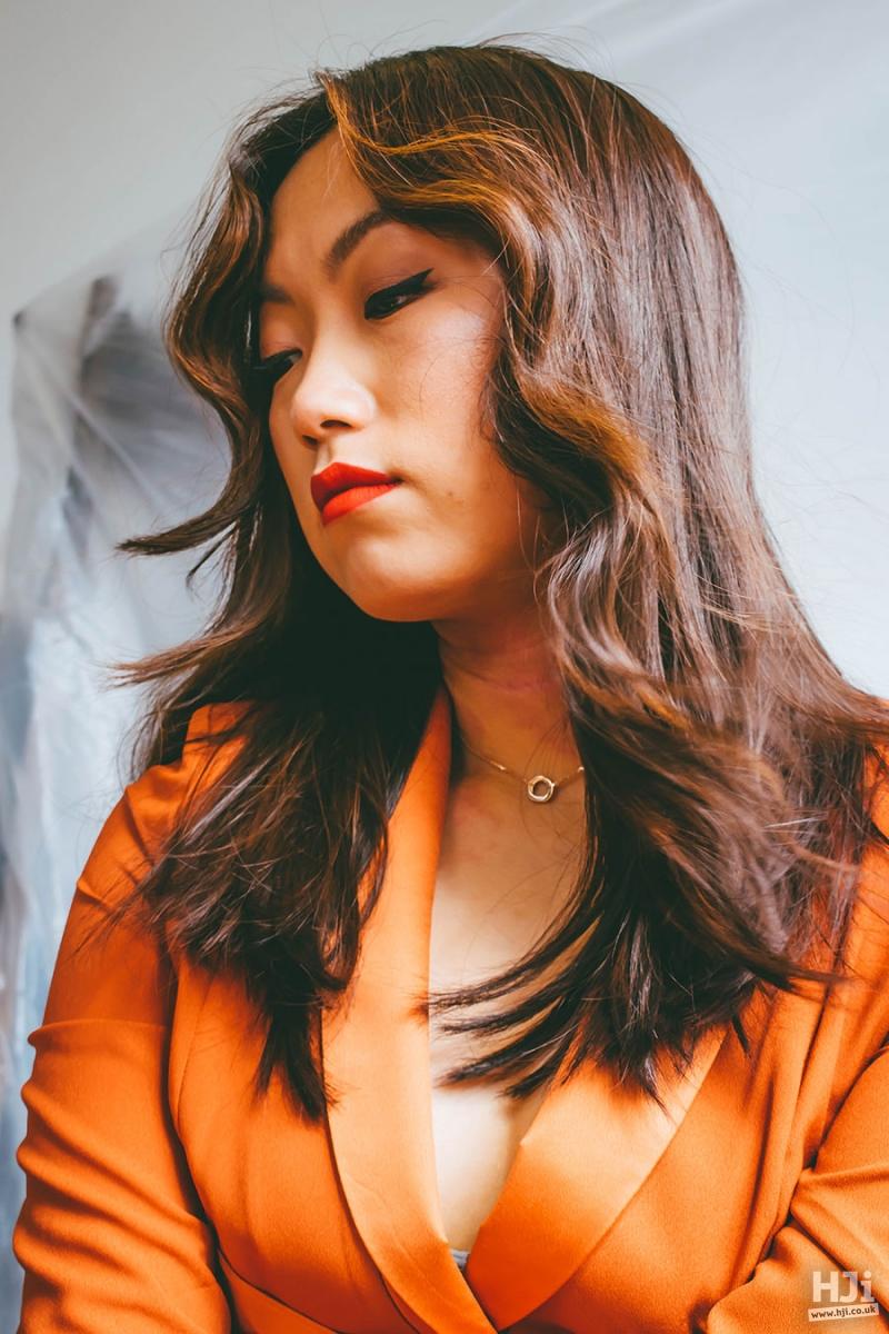 Mid-length, brunette, middle parting light auburn highlights