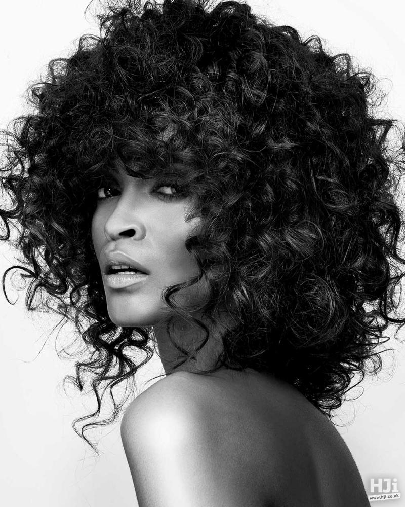 Black mid-length afro curls