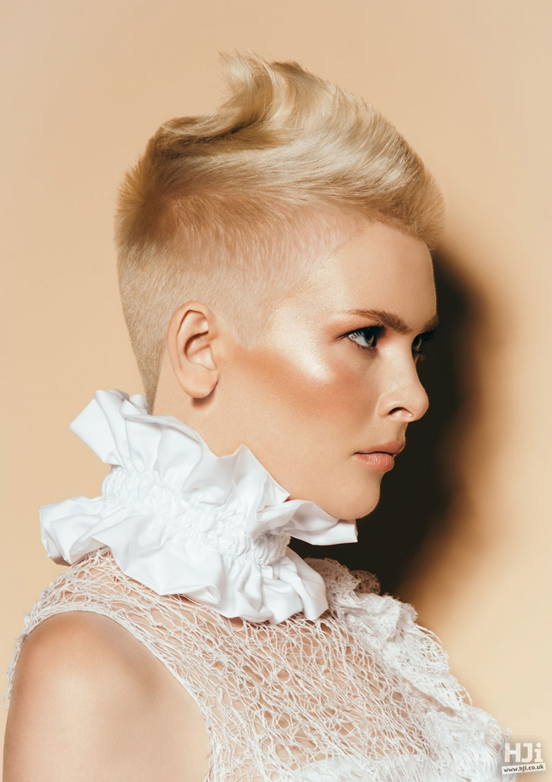 Golden blonde undercut with highlights and a subtle mohawk