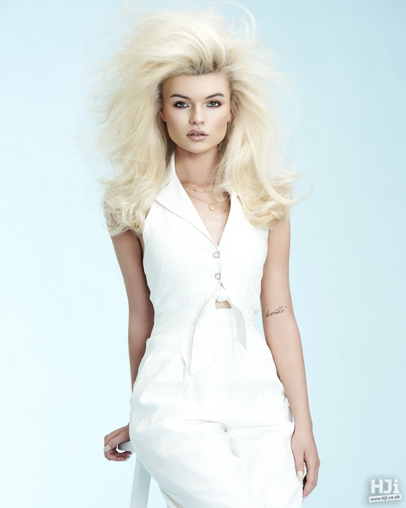Mid-length side-parted bleach blonde with volume